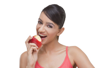 Close-up portrait of pretty woman with bitten apple