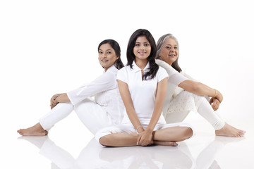 Multi generation family sitting on floor