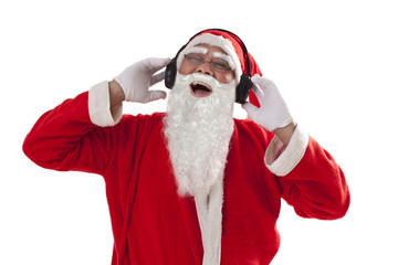 Santa Claus laughing while listening to music from headset over white background