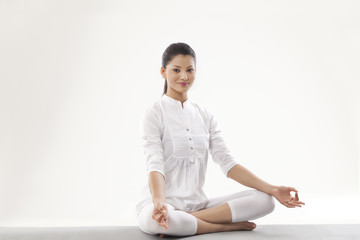 Portrait of smiling young woman meditating