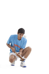 Full length of man in sportswear practicing hockey isolated over white background
