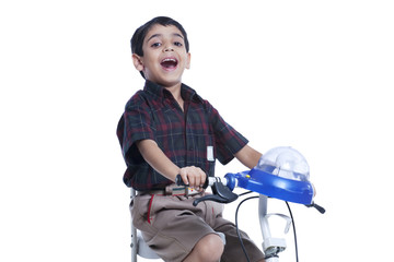 School child riding bicycle against white background