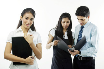 Businesspeople looking at a file
