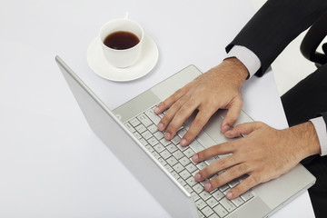 Close-up of hands of a businessman on a laptop