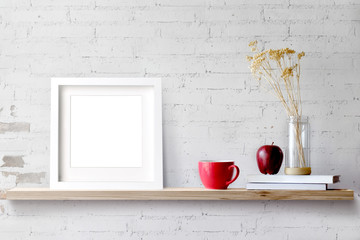 Wood shelf with blank white frame and coffee. Blank screen for products or graphic montage.