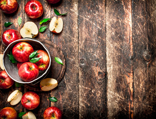Red apples in an old bucket.