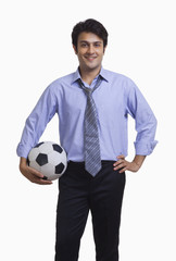 Executive holding football