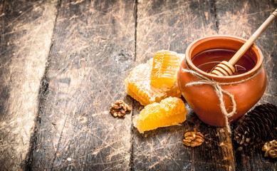 Wall Mural - The honey in the pot with the nuts and cones.