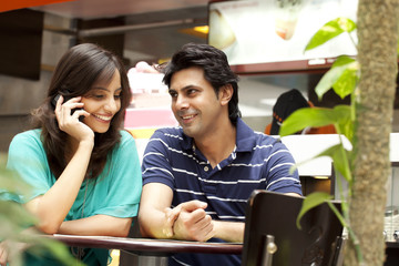 Smiling couple in shopping mall
