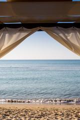 White canopie on a beach