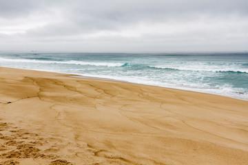 Arena y oleaje en la Playa de las Furnas, Porto do Son, La Coruña, Galicia.