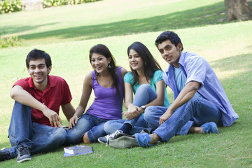 Group of friends sitting in lawn