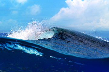 Big blue surfing wave in the ocean
