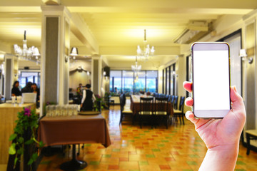 Set of hand holding smartphone on the restaurant background or Use techonology of smartphone for making a reservation in the restaurant