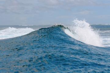 rough white blue ocean wave falling down