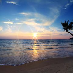 beautiful tropical beach with yellow sand breaking splashing shorebreak under sunset