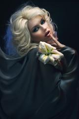 Fashion creative portrait of a blonde girl