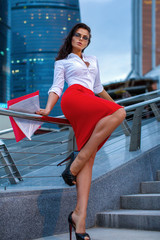 Office woman in front of busines city