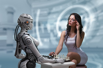 A girl playing chest with a robot