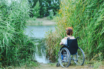 Woman in wheelchair, enjoying time outdoors