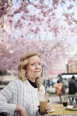 Woman havin coffe in a park