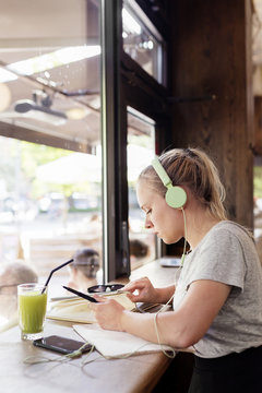 Sitting girl with headphones