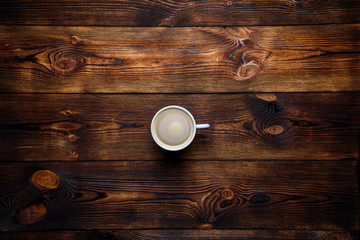 Coffee on a brown wooden background