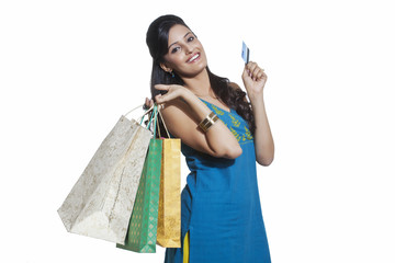 Portrait of a woman with shopping bags and credit card