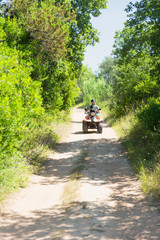 Driving quad bike on a dirt road