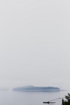 USA, Bar Harbor, Maine. Bar Island in the Frenchman Bay in the mist.