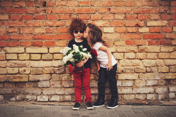 little boy and girl on the street