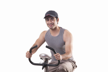 Portrait of a young man exercising over white background