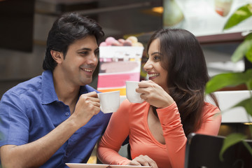 Couple enjoying a cup of tea in shopping mall