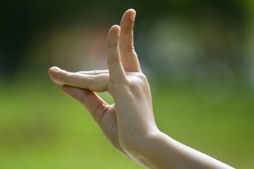 Close-up of woman's hand in yoga gesture