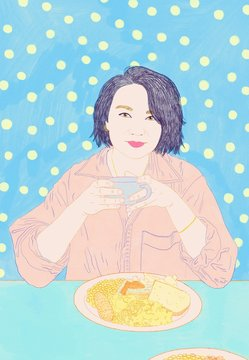 Young Beautiful Asian Woman Drinking Coffee and Eating Breakfast
