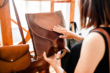 Handmade vintage crafted authentic leather high quality woman handbag on the sale at the window in shop