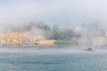 Printed kitchen splashbacks City on the water Porto in Portugal, panorama, view of the Douro river in the mist, with a traditional boat