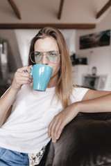 Blond woman drinking tea