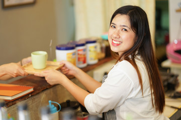 close up asian woman barista trying to preparing coffee in restaurant with waitress,startup owner concept