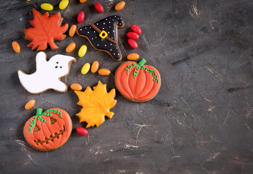 Beautiful and delicious ginger biscuits for Halloween on the background. Halloween background Halloween sweets Top view
