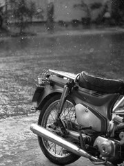 BLACK AND WHITE PHOTO OF MOTORCYCLE AND CLOSE-UP OF RAINDROPS