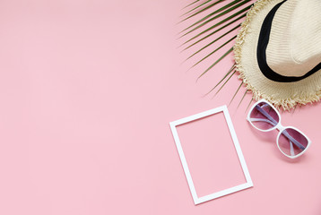Happy Summer concept hat and sunglasses on pink background.,copy space,flat lay