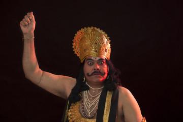 Portrait of a man dressed as Raavan gesturing