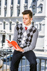 Young American Man Reading Outside in New York