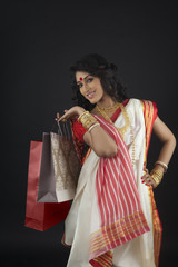 Portrait of Bengali woman with shopping bags