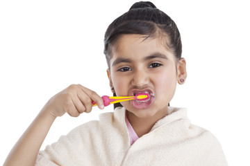 Portrait of little girl brushing her teeth