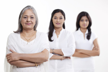 Portrait of multi generation family standing over white background