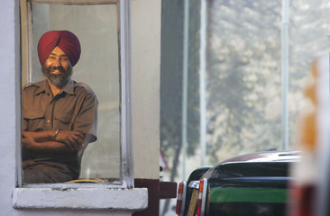 Portrait of a Sikh taxi driver at the taxi service