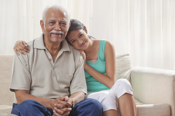 Portrait of a grandfather and granddaughter