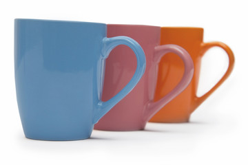 Colourful mugs in a row